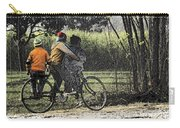 3 Young Children On A Cycle At The Side Of The Road Carry-all Pouch