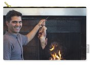 A Cook Hangs A Turkey Over Fire Pit Carry-all Pouch