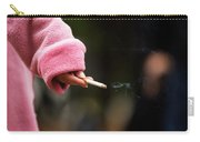 A Hand Holding A Cigarette Carry-all Pouch