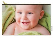 A Happy Baby Lying On Bed In Green Towel Carry-all Pouch