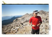 A Hiker Uses His Smartphone To Capture Carry-all Pouch