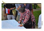 A Lady Signs Petition At May Day Rally Singapore Carry-all Pouch