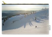 A Lone Skier Makes A Turn At Whitefish Carry-all Pouch