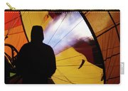 A Man As He Inflates A Hot Air Balloon Carry-all Pouch