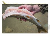 A Man Cleans A Lake Trout Fish Carry-all Pouch