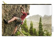 A Man Clinging To Rock Face In The Carry-all Pouch