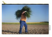 A Man Harvests Sedge To Be Used Carry-all Pouch