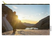 A Man Hiking On Snowfield At Sunrise Carry-all Pouch