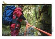 A Man Lowers A Rope For Canyoning Carry-all Pouch