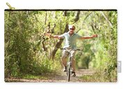 A Man Rides A Bicycle Carry-all Pouch