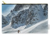 A Man Ski Touring In The Mountains Carry-all Pouch