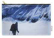 A Man Ski Touring Under Blue Skies Carry-all Pouch