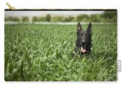 A Military Working Dog Sits In A Field Carry-all Pouch by Stocktrek Images