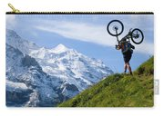 A Mountain Biker Is Carrying His Bike Carry-all Pouch