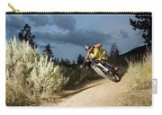 A Mountain Biker Rides A Trail Carry-all Pouch