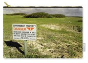 A Sign Warns Of Dangerous Unexploded Carry-all Pouch