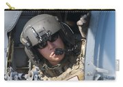 A U.s. Air Force Airman Peers Carry-all Pouch