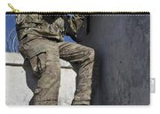 A U.s. Soldier Provides Security At An Carry-all Pouch
