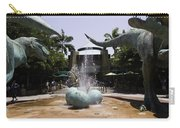 A Water Fountain With Dinosaur Eggs And Dinsosaurs In Universal Studios Carry-all Pouch
