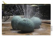 A Water Fountain With Dinosaur Eggs In The Universal Studios Singapore Carry-all Pouch