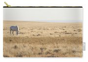 A White Mustang Feeds On Dry Grass Fields Of Arizona Carry-all Pouch