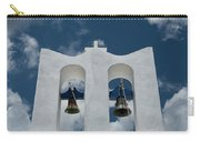 A Whitewashed Bell Tower And Dramatic Carry-all Pouch