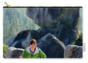 A Woman Hiking High In The Mountains Carry-all Pouch
