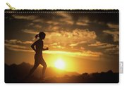 A Woman Jogs Under Sunset Carry-all Pouch