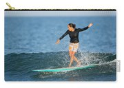A Woman Rides A Wave On A Longboard Carry-all Pouch