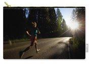 A Woman Running On A Country Road Carry-all Pouch