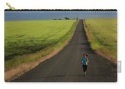 A Woman Running On A Dirt Road Carry-all Pouch