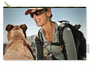 A Woman  Talks To Her Dog While Taking Carry-all Pouch