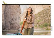 A Woman Unloads Gear From Her Canoe Carry-all Pouch