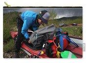 A Woman Unloads Her Kayak Carry-all Pouch