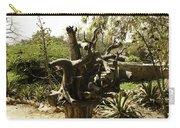 A Wooden Sculpture Inside A Garden Carry-all Pouch