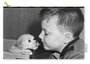 A Young Boy Is Face To Face With A Puppy Tongue. Carry-all Pouch