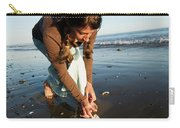 A Young Woman Collects Seashells Carry-all Pouch
