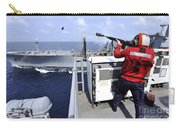 Airman Fires A Shot Line From Uss Carry-all Pouch