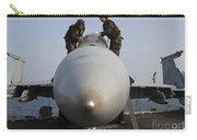 Airmen Clean The Canopy Of An Fa-18f Carry-all Pouch by Stocktrek Images