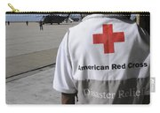 An American Red Cross Volunteer Waits Carry-all Pouch