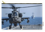 An Army Ah-64d Apache Helicopter Takes Carry-all Pouch