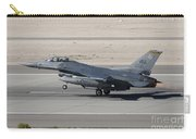 An F-16c Fighting Falcon Taking Carry-all Pouch