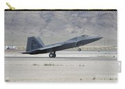 An F-22 Raptor Landing On The Runway Carry-all Pouch