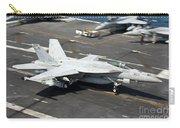 An Fa-18e Super Hornet Hooks An Carry-all Pouch