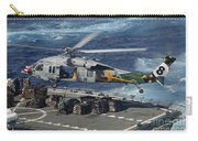 An Mh-60s Sea Hawk Helicopter Picks Carry-all Pouch