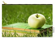 Apple On Pile Of Books On Grass Carry-all Pouch
