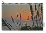 as the sun sets at Seascape Carry-all Pouch