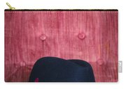 Black Hat On Red Velvet Chair Carry-all Pouch by Edward Fielding