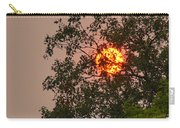 Blazing Sun Hiding Behind A Tree Carry-all Pouch