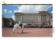 British Royal Guards Riding On Horse And Perform The Changing Of The Guard In Buckingham Palace Carry-all Pouch